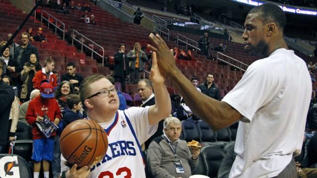 Feb 18 2014 Philadelphia PA USA Bensalem senior Kevin Grow left who has Down syndrome giv