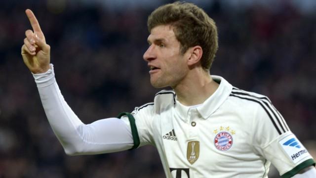 Bayern Munich's Mueller celebrates after scoring during the German Bundesliga first division soccer match against Hanover 96 in Hanover