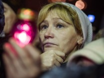 Anti government protesters listen to Yulia Tymoshenko in Kiev