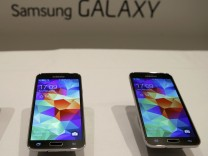 New Samsung Galaxy S5 smartphones are seen on a display at the Mobile World Congress in Barcelona