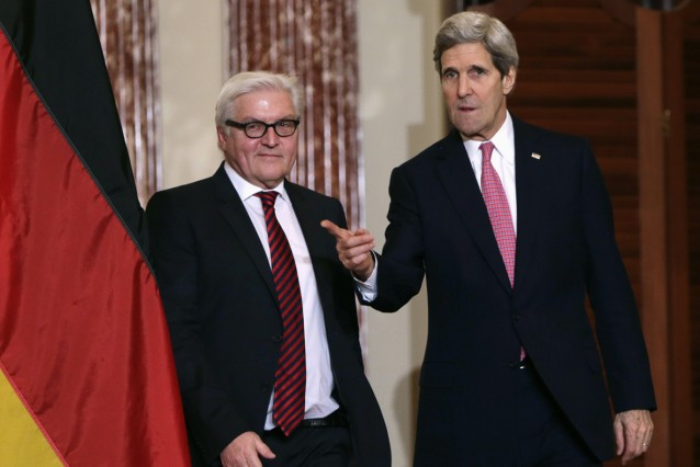 Germany's Foreign Minister Frank-Walter Steinmeier and U.S. Secretary of State John Kerry arrive at their joint news conference at the State Department in Washington