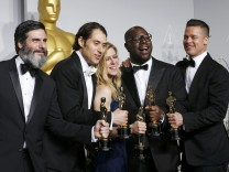 Producers Anthony Katagas, Jeremy Kliner, Dede Gardner, Steve McQueen and Brad Pitt pose with their awards for best picture for '12 Years a Slave' at the 86th Academy Awards in Hollywood