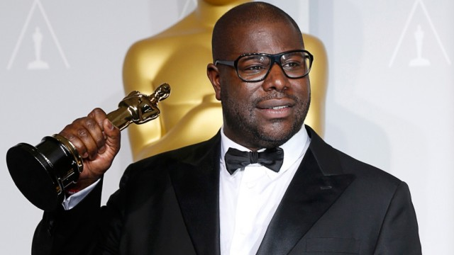 '12 Years a Slave' director Steve McQueen poses with his best picture Oscar backstage at the 86th Academy Awards in Hollywood