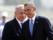 U.S. President Obama and Israeli Prime Minister Netanyahu walk during an official welcoming ceremony at Ben Gurion International Airport near Tel Aviv