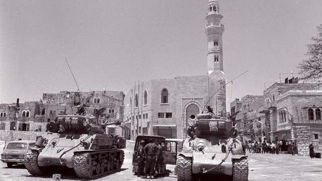 Two Israeli US-made Super-Sherman tanks patrol 10