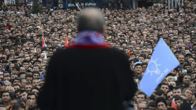 Turkey's Prime Minister Erdogan addresses supporters during an election rally of his ruling AK Party