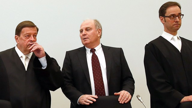 Bayern Munich President Hoeness arrives with his lawyers before verdict in his trial for tax evasion at regional court in Munich