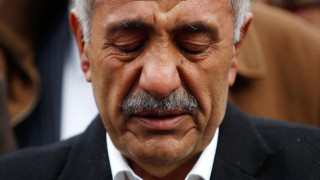 File photo of Ismail Yozgat crying in front of a memorial to his son Halit Yozgat who was killed by NSU in Kassel