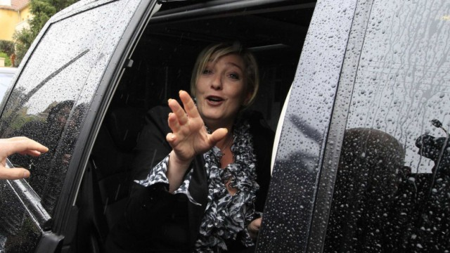 France's far right National Front party leader Le Pen leaves for her party's headquarters in Nanterre