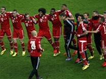 Bayern Munich's players celebrate after Bundesliga soccer match Hertha Berlin  in Berlin