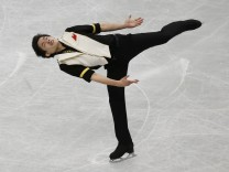 Japan's Takahiko Kozuka competes during the men's short program at the ISU World Figure Skating Championships in Saitama