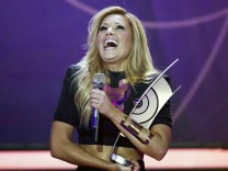 German singer Fischer celebrates with her award for Best album of the year during the 2014 Echo Music Awards in Berlin