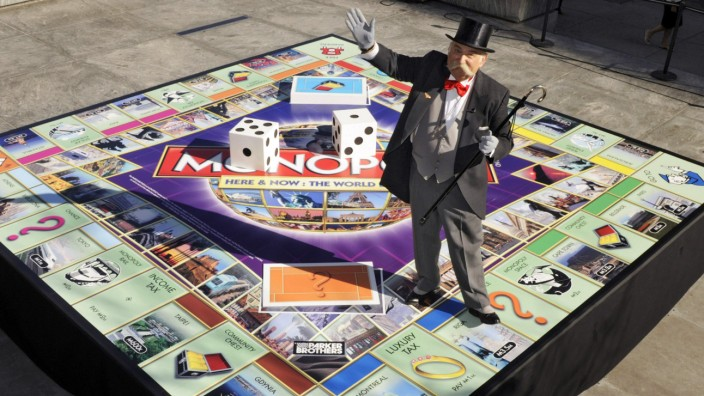 File photo of Mr. Monopoly showing new 'Monopoly Here & Now: The World Edition' game board at unveiling in New York