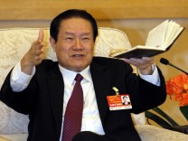 File photo of Chinese former Politburo Standing Committee Member Zhou Yongkang gesturing in Beijing