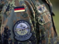 The patch of the NATO AWACS (Airborne Warning and Control Systems) aircraft is seen attached to the uniform of a soldier at the AWACS air base in Geilenkirchen near the German-Dutch border