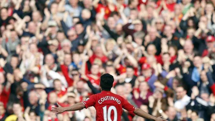 Liverpool's Coutinho celebrates scoring against Tottenham Hotspur during their English Premier League soccer match at Anfield in Liverpool