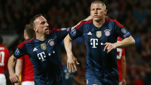 Bayern Munich's Schweinsteiger celebrates with Ribery after scoring a goal against Manchester United during their Champions League quarter-final first leg soccer match at Old Trafford in Manchester