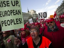 Woman shouts slogans as she protests during a demonstration against European and Spanish austerity measures in Madrid