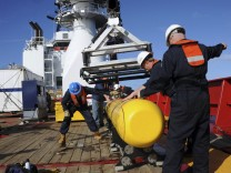 Bluefin 21, the Artemis AUV, is hoisted back on board the Australian Defence Vessel Ocean Shield after a buoyancy test in the southern Indian Ocean during the continuing search for missing Malaysian Airlines flight MH370