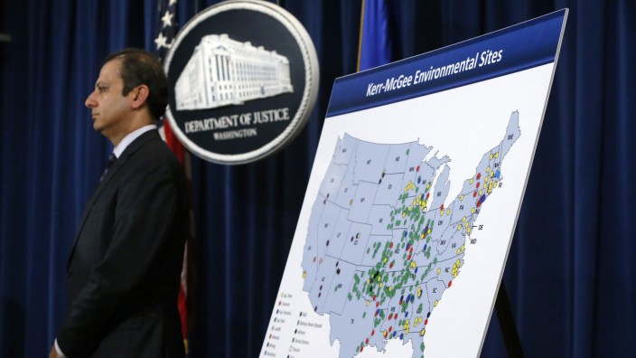 U.S. Attorney for the Southern District of New York Bharara stands beside a map during an announcement of a settlement with Anadarko Petroleum Corp in Washington