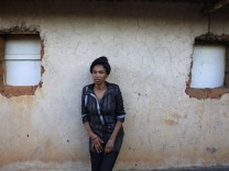 Ernestine poses for photographs outside her home on the 20th anniversary of the genocide in Kigali