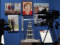 A portrait of German Chancellor Merkel, painted by former U.S. President  Bush, hangs on display during 'The Art of Leadership: A President's Personal Diplomacy' exhibit at the George W. Bush Presidential Library and Museum in Dallas