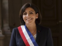 France's newly elected Socialist Paris mayor Hidalgo poses after the Paris council elected her into the post, in Paris