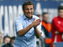Augsburg's coach Markus Weinzierl gestures during their German first division Bundesliga soccer match against Bayern Munich in Augsburg