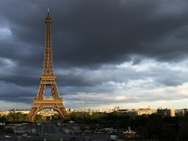 The Eiffel Tower is seen under clouds in Paris, Reuters