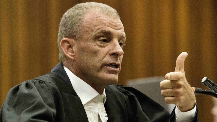 State prosecutor Nel gestures as he cross examines Pistorius during his ongoing murder trial in Pretoria