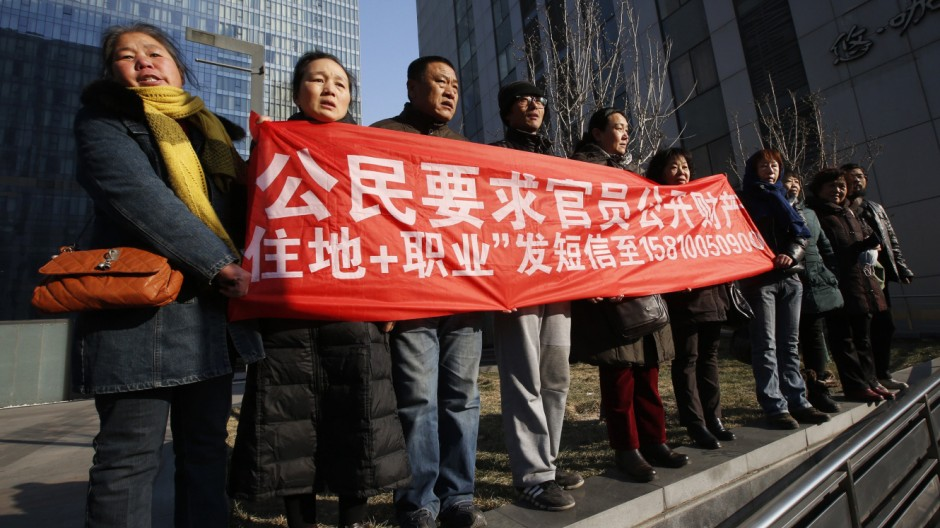 Supporters of Xu Zhiyong shout slogans near a court where Xu's trial is being held, in Beijing
