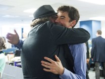 Handout of Washington Post reporter Eli Saslow embracing Post photographer Michael S. Williamson after the Pulitzer prizes were announced in Washington