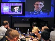 Putin und Snowden