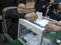 Algeria's President Abdelaziz Bouteflika casts his ballot during the presidential election in Algiers