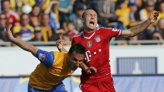 Bayern Munich's Robben and Eintracht Braunschweig's Dogan fight for the ball during their Bundesliga soccer match in Berlin