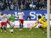 VfL Wolfsburg's De Bruyne scores goal past Hamburger SV's goalkeeper Adler during their Bundesliga soccer match in Hamburg