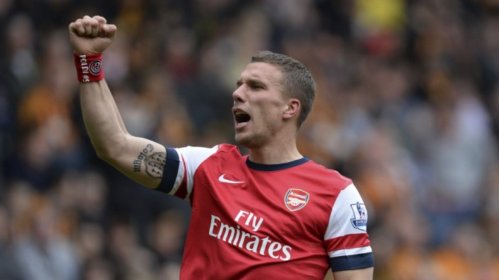 Arsenal's Podolski celebrates after scoring a second goal against Hull City during their English Premier League soccer match at the KC Stadium in Hull