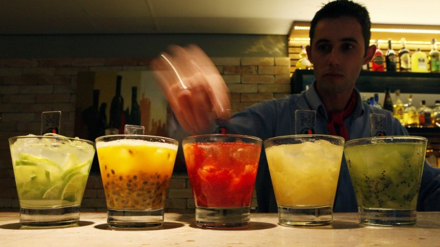 A barman prepares 'Caipirinhas', Brazil's national cocktail, in Sao Paulo