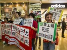 2014-04-24T071336Z_727106995_GM1EA4O15AO01_RTRMADP_3_CHINA-STRIKE-DETENTION