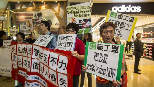 Protesters from labour organizations shout slogans in support of the strike by workers at a Yue Yuen Industrial Holdings Ltd shoe factory complex in Dongguan, at a shopping mall in Hong Kong