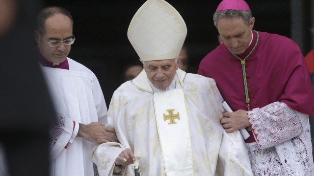 Former Pope Benedict XVI arrives to attend the canonisation ceremony of Popes John XXIII and John Paul II to start in St. Peter's Square at the Vatican