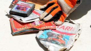 The first recovered Atari cartridge and packaging recovered from the old Alamogordo landfill are shown in Alamogordo