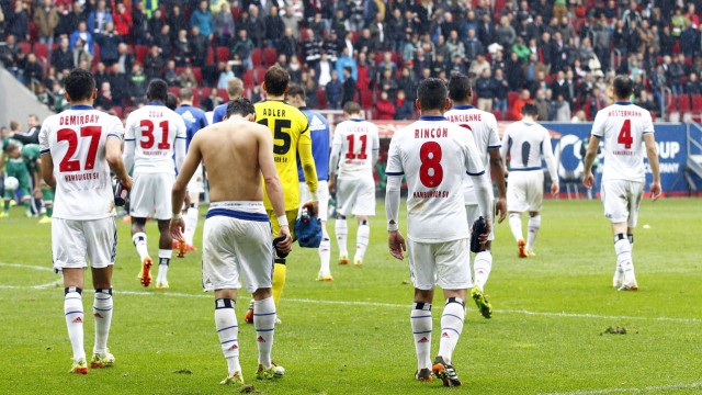 Hamburger SV's players leave the pitch after their German first division Bundesliga soccer match against Augsburg in Augsburg
