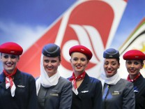 File photo of Air Berlin and Etihad Airways staff posing before a news conference at Schoenefeld airport south of Berlin