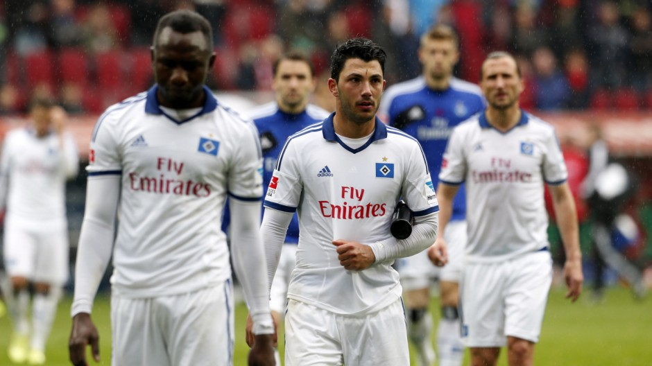 Hamburger SV players react after their German first division Bundesliga soccer match against Augsburg in Augsburg