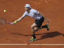 Haas of Germany hits a return to Djokovic of Serbia during their men's singles quarter-final match at the French Open tennis tournament in Paris
