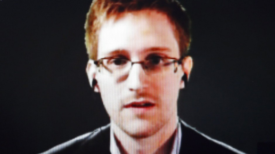 File photo of accused U.S. government whistleblower Snowden speaking via video conference in Strasbourg