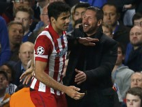 Atletico Madrid's Costa celebrates with team coach Simeone after scoring a penalty shot for the team during their Champions League semi-final second leg soccer match against Chelsea at Stamford Bridge Stadium in London