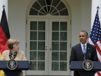 U.S. President Obama and German Chancellor Merkel address joint news conference in the White House Rose Garden in Washington