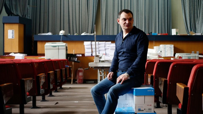 Lyagin, leader of the separatist republic's election commission, sits on boxes of ballots at the commission headquarters in Donetsk, eastern Ukraine